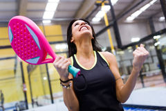 Paddle tennis player celebrating a win. Stock Photos