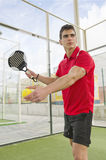 Paddle tennis player ready for serve Stock Image