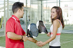 Paddle tennis players fair play. Handshake of paddle tennis players women and man royalty free stock photos
