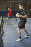 Paddle tennis players. Stock Images