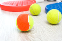 Paddle tennis rackets and ball Stock Image