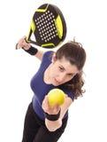 Feminine paddle tennis. Paddle tennis serve, isolated girl royalty free stock photos