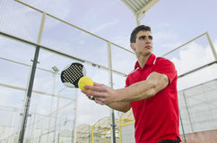 Paddle tennis serve Royalty Free Stock Image