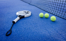 Paddle tennis still life. Paddle tennis objects on artificial turf ready for tournament, focus in second ball royalty free stock photography