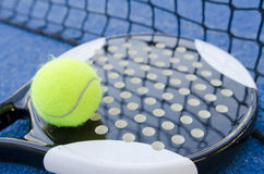 Paddle tennis still life. Paddle tennis objects ion artificial turf ready for tournament Stock Image