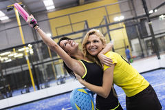 Paddle tennis team celebrating a win. Stock Images