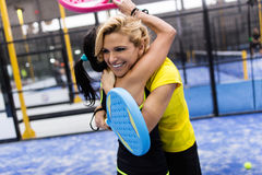 Paddle tennis team celebrating a win. Royalty Free Stock Image