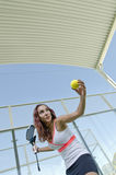 Paddle tennis woman ready for serve. Ball at indoor court Stock Photo