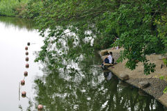 Paddle. There are young people in the water in the river bank Stock Images