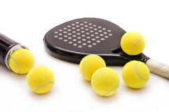 Paddle time. Isolated paddle tennis objects and balls tube Stock Photo