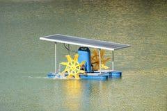 Paddle wheel aerator using solar energy panel Royalty Free Stock Images