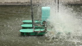 Paddle wheel aerator working in wastewater treatment stock footage