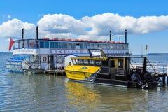 Two tourist boats on Lake Rotorua, New Zealand, a paddlewheeler and a water taxi stock image