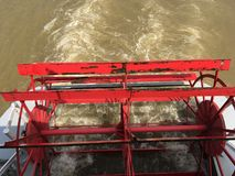 Paddle wheel power. A paddle wheel propels a riverboat through the water Stock Images