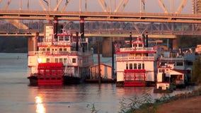Paddle Wheel steamer on Ohio River at golden sunset  City of Cincinnati stock video