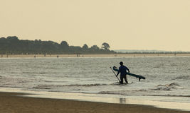 Paddleboarder at Dawn Stock Photography