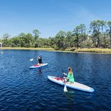 Paddleboarders bij Waterverftoevlucht royalty-vrije stock fotografie