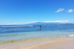Paddleboarding along Maui shoreline. Stock Photo