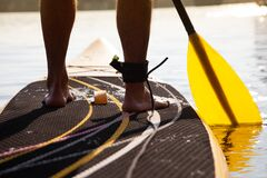 Free Paddleboarding On A Lake, View Of The Legs Stock Images - 180422524
