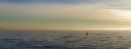 Paddleboarding on open sea solo, watersports with beautiful landscape background, palma, mallorca, spain stock photography
