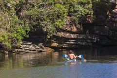 Paddler Canoe Lagoon Cliffs Royalty Free Stock Photography