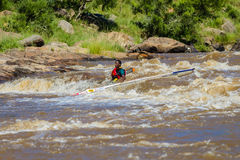 Paddler Canoe Under Water Rapids Royalty Free Stock Photos