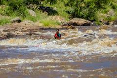 Paddler Canoe Under Water Rapids Royalty Free Stock Photos