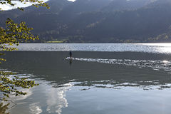 The paddler. A paddler in a lake in i beautiful scene Stock Image