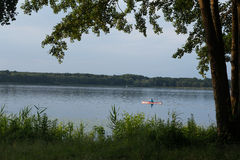 Paddler on the lake Royalty Free Stock Images