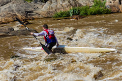 Paddler Out River Rocks Royalty Free Stock Photos