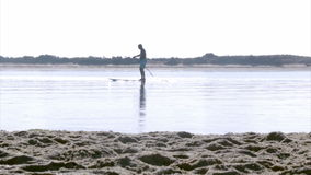 Paddler silhouette at Fuseta, in Ria Formosa wetlands landscape, Algarve, southern Portugal. stock footage