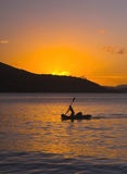 Paddler in Sunset Stock Photo