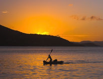 Paddler in Sunset Stock Photos
