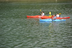 Three Paddlers on the River Rhine Royalty Free Stock Photos