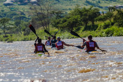 Paddlers Chasing Canoe Race Stock Photo