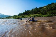 Paddlers Chasing Dusi Canoe Race Stock Images