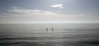Paddlers at midday in the bay of palma in the island of mallorca Royalty Free Stock Image