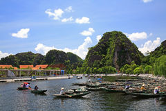 Paddlers sailing boat at Tam Coc port Stock Image