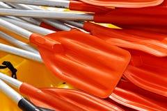 Paddles. Detail of orange paddles for kayaking stock photo