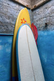 Paddles-boards with oars standing in corner Stock Image