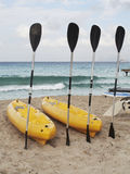 Paddles and kayaks on the beach Royalty Free Stock Photo