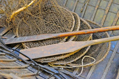 Paddles and net. In a vintage boat Stock Photos