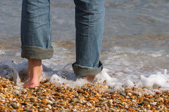 Paddling. A man going paddling in the sea Stock Photo