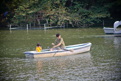 Paddling a boat with family in a park Stock Image