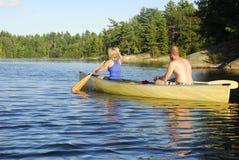 Paddling Through Calm Water Royalty Free Stock Photos