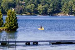Paddling a canoe Stock Photography