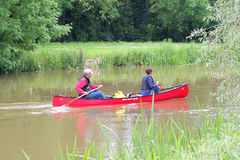 Paddling a canoe. Royalty Free Stock Image