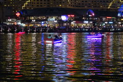 Romantic paddling in Darling Harbour by night Stock Photo