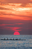Paddling Home. Hawaiian canoe coming home at sunset royalty free stock photo