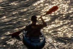 Paddling in a kayak. Men paddling in a kayak Royalty Free Stock Image